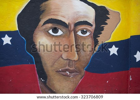 OTAVALO, ECUADOR, FEB 28: Graffiti on wall, composition of Ecuador flag and Simon Bolivar. Ecuador 2015.