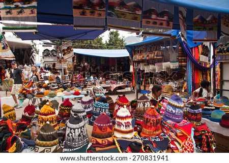 OTAVALO, ECUADOR - FEBRUARY 27, 2010: Colorful textile stall with hats in the popular Otavalo market. - stock photo