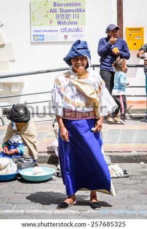 OTAVALO, ECUADOR - JAN 3, 2015: Unidentified Ecuadorian woman at the Otavalo Market. 71,9% of Ecuadorian people belong to the Mestizo ethnic group - stock photo