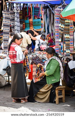 OTAVALO, ECUADOR - JAN 3, 2015: Unidentified Ecuadorian woman in traditional clothes at the Otavalo Market. 71,9% of Ecuadorian people belong to the Mestizo ethnic group - stock photo