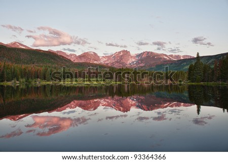 Otis, Hallett and Flattop Mountains seen from Sprague Lake in Rocky Mountain National Park in northern Colorado - stock photo