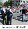 OTTAWA - AUG. 19: Protester hollers at 2 Royal Canadian Mounted Police during the protest of the Security and Prosperity Partnership talks in Ottawa, Canada on Aug. 19, 2007. - stock photo