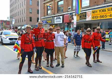 OTTAWA - AUGUST 24, 2014: Members of the Royal Canadian Mounted Police partake in the annual Gay Pride Parade on Bank Street in Ottawa.  - stock photo