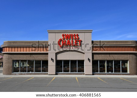 OTTAWA, CANADA - APRIL 17, 2016:  Swiss Chalet is a popular casual dining chain.  It was founded in 1954 in Toronto and now has over 200 locations in Canada. - stock photo