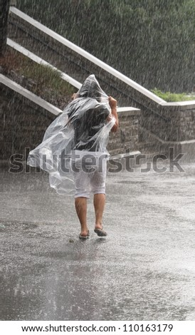 OTTAWA, CANADA - AUGUST 5: A woman walking in the rain at the Ottawa Locks during the    annual Rideau Canal Festival on August 5, 2012 in Ottawa, Ontario. The canal is a UNESCO World Heritage Site.
