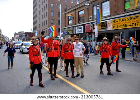 OTTAWA, CANADA - AUGUST 24, 2014:  Members of the Royal Canadian Mounted Police partake in the annual Gay Pride Parade on Bank Street in Ottawa. - stock photo