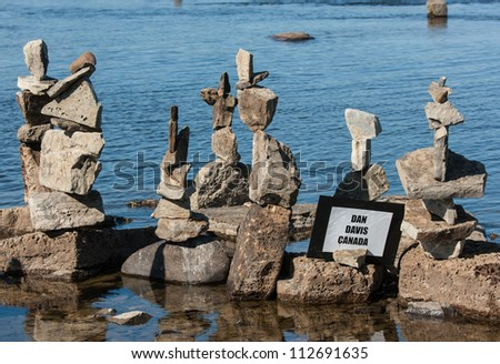 OTTAWA, CANADA - AUGUST 18: Stones balanced by Dan Davis of Canada as part of the  International Stone Balance Festival on August 18, 2012 at Remic Rapids in Ottawa, Ontario. - stock photo