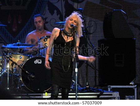 OTTAWA, CANADA - JULY 9:  Courtney Love and her band Hole perform at the Ottawa Bluesfest which was established in 1994.  July 9, 2010, which was also her birthday, in Ottawa, Ontario.