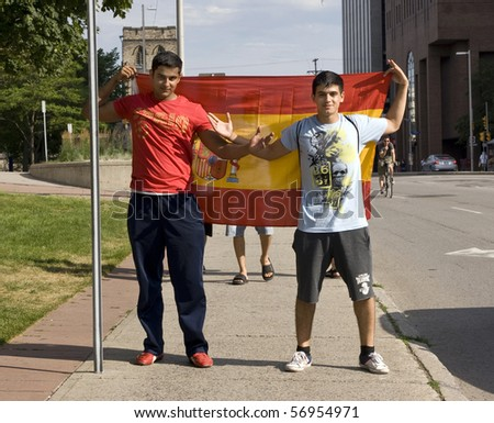 OTTAWA, CANADA - JULY 11:  Spanish fans celebrate on Elgin Street moments after Spain defeats the Netherlands to win the World Cup July 11, 2010 in Ottawa, Ontario. - stock photo