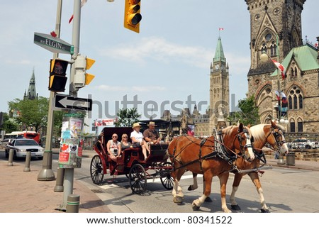 OTTAWA, CANADA - JULY 2:  Tourists take a ride through Ottawa during a Canada Day weekend that broke records for attendance partly due to visit by William and Kate. July 2, 2011 in Ottawa, Ontario. - stock photo