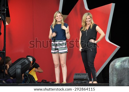 Ottawa, Canada - June 30, 2015:TV personality Anne-Marie Withenshaw and Olympic gold medalist Jennifer Jones in rehearsal for their role as hosts for the Canada Day concert scheduled for the next day.