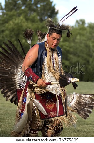 OTTAWA, CANADA - JUNE 16: Unidentified indian dances in full dress during the Powwow festival at Dows lake in Ottawa Canada on  June 16, 2007. - stock photo