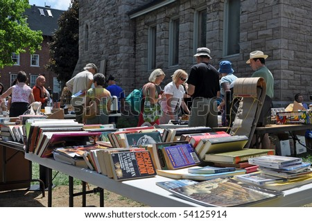 OTTAWA, CANADA MAY 29:   Thousands of people gather at the annual Glebe neighborhood garage sale which takes place for several blocks in the Glebe area of Ottawa, Ontario May 29, 2010. - stock photo