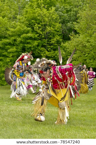 OTTAWA, CANADA - MAY 28: Unidentified aboriginal dancers in full dress and head regalia during the Powwow festival at Ottawa Municipal Campground in Ottawa Canada on May 28, 2011. - stock photo