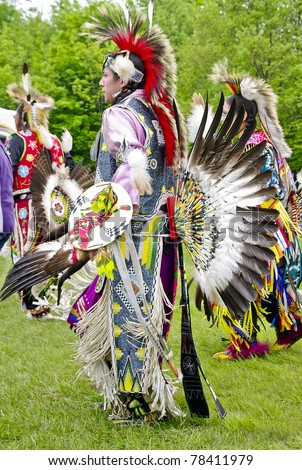 OTTAWA, CANADA - MAY 28: Unidentified aboriginal men and women dancers in full dress and head regalia during the Powwow festival at Ottawa Municipal Campground in Ottawa Canada on May 28, 2011. - stock photo