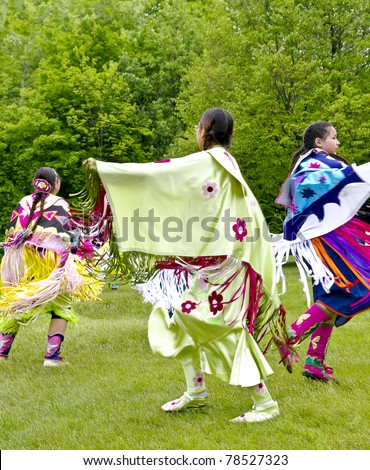 OTTAWA, CANADA - MAY 28: Unidentified aboriginal women dancers in full dress regalia during the Powwow festival at Ottawa Municipal Campground in Ottawa Canada on May 28, 2011. - stock photo
