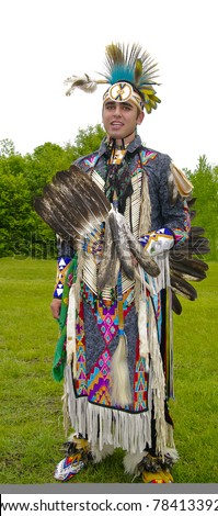 OTTAWA, CANADA - MAY 28: Unidentified aboriginal young man in full dress and head regalia during the Powwow festival at Ottawa Municipal Campground in Ottawa Canada on May 28, 2011. - stock photo