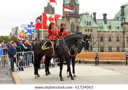 OTTAWA, CANADA - SEPT 26:  Royal Canadian Mounted Police on duty at the National Police and Peace Officer's Memorial on Parliament Hill.  September 26, 2010 Ottawa, Ontario. - stock photo