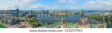 Ottawa cityscape panorama in the day over river with historical architecture. - stock photo