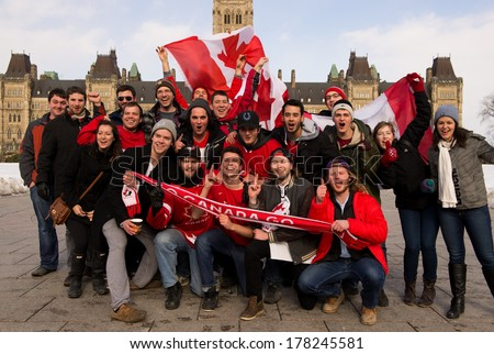OTTAWA - FEB 23: Canadians gather on Parliament Hill at 10 am to celebrate Canada's defense of Olympic hockey gold with 3-0 win over Sweden on Feb 23, 2014 in Ottawa, Canada - stock photo