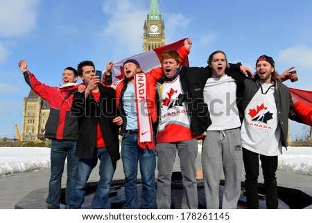OTTAWA - FEB 23: Canadians sing national anthem to celebrate Canada's defense of Olympic hockey gold with 3-0 win over Sweden on Parliament Hill 10:06 am Feb 23, 2014 in Ottawa, Canada - stock photo