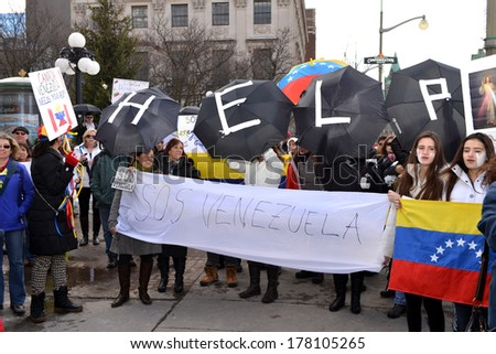 OTTAWA - FEB 22:  Venezuelans gather in front of Parliament Hill to bring attention to the plight of their countrymen who are protesting against the Venezuelan Government Feb 22, 2014 Ottawa, Canada.  - stock photo