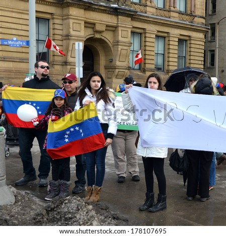 OTTAWA -FEB 22:  Venezuelans gather in front of Parliament Hill to bring attention to the plight of their countrymen who are protesting against the Venezuelan Government Feb 22, 2014 Ottawa, Canada.  - stock photo