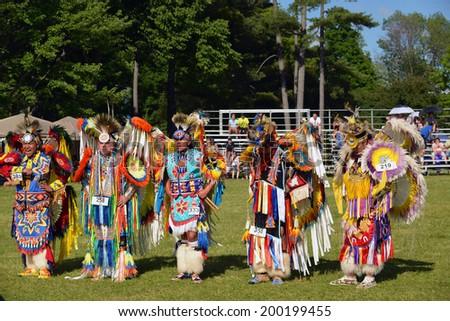 OTTAWA - JUN 22: Native men stand before judges after performing traditional dance in Summer Solstice Aboriginal Arts Festival for Aboriginal Day in Massey Park June 22, 2014 in Ottawa, Canada - stock photo