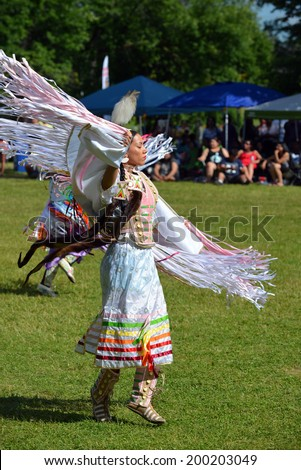 OTTAWA - JUN 22: Native woman performs a traditional dance in Summer Solstice Aboriginal Arts Festival for Aboriginal Day in Massey Park June 22, 2014 in Ottawa, Canada - stock photo