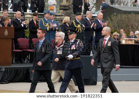 OTTAWA - MAY 9:  Prime Minister Stephen Harper and Governor General David Johnston honour families of soldiers killed in Afghanistan, at ceremonies in Ottawa, May 9, 2014. - stock photo