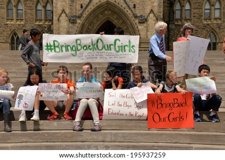 OTTAWA - MAY 22:  School children gather for a rally to activate governments to rescue the girls in Nigeria and protect school girls across the world on Parliament Hill  May 22, 2014 in Ottawa, Canada - stock photo
