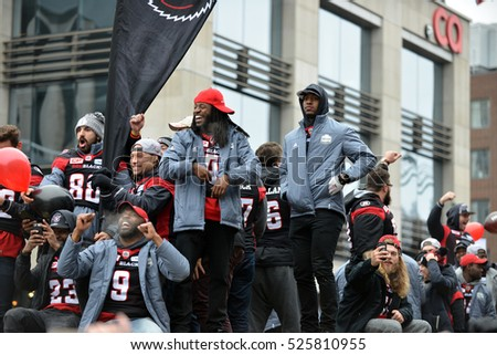 OTTAWA - NOV 29, 2016:  The Ottawa Redblacks during the Grey Cup Parade celebrating the city's first CFL championship in 40 years, with an upset win over the Calgary Stampeders.