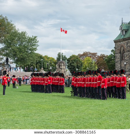 OTTAWA,ON - AUGUST 13 : Changing of the guard ceremony on Canada's parliament hill, Ottawa,Ontario august 13th, 2015.It is a parade representing the changing of the guards posted at Rideau Hall