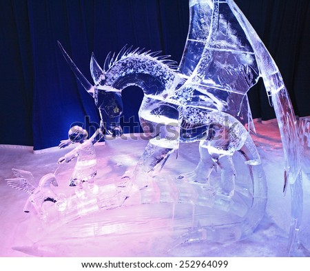 OTTAWA, ON - FEB 14: Ice sculpture of dragon and girl, illuminated at night in Confederation Park, Winterlude Event, on Feb 14, 2015 in Ottawa, ON, Canada