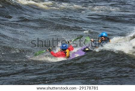 OTTAWA, ONTARIO - APRIL 25: A father and son in a dual kayak competing at The Level Six Capital Cup kayaking competition on April 25, 2009 in Ottawa, Ontario, Canada.