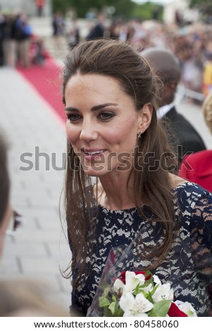 OTTAWA, ONTARIO, CANADA - JUNE 30 - The Duchess of Cambridge greets the crowd after laying a wreath at the War Memorial on June 30, 2011 in Ottawa, Ontario, Canada. - stock photo