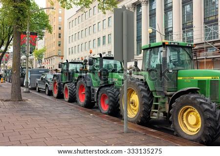 OTTAWA, SEP. 30: John Deere farm tractors parked in Parliament Hill, Ottawa, Ontario, Canada taken on Sep. 30, 2015. - stock photo
