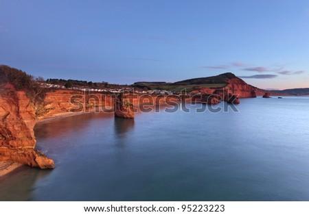 Otterton sandstone cliffs and seastack at Ladram Bay, South Devon, England - stock photo