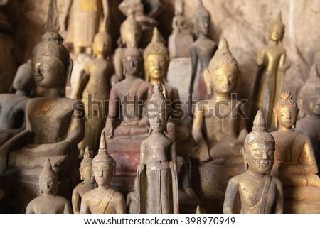 Ou Pak Caves with Buddha statues, Laos - stock photo