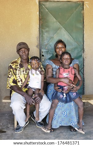 OUAGADOUGOU, BURKINA FASO - NOVEMBER 16: portrait of an African family outside his home in Ouagadougou, november 16, 2010 - stock photo