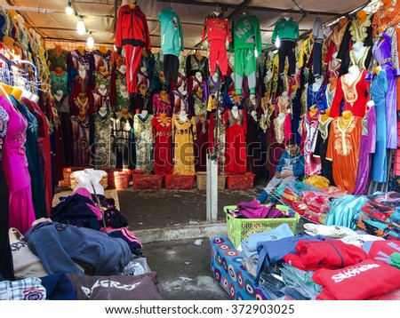 OUARGLA, ALGERIA - 30 JAN 2016: A market(souk) bazaar in touristic city Ouargla Algeria. Traditional cloth market is the one of the attaction point in the city. - stock photo