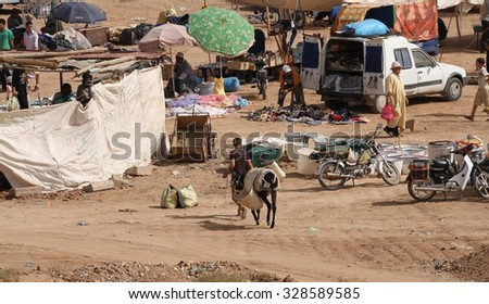 OUARZAZATE, MOROCCO - AUGUST 12: A view of the busy weekly souk outside of Ait Ben Haddou near Ouarzazate, Morocco on the 12th August, 2015.