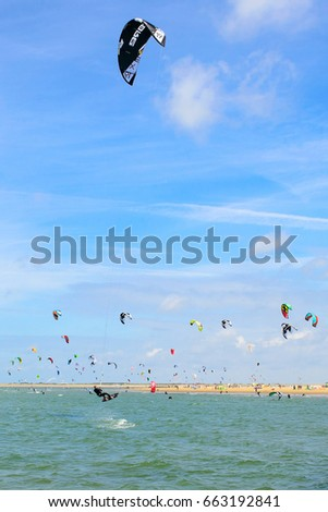 Ouddorp, Netherlands - June 16, 2017: Kite surfing near the coastline of the Brouwersdam in the Netherlands.