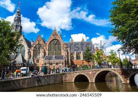 Oude Kerk (Old Church) and Voorburgwal canal in Amsterdam - stock photo