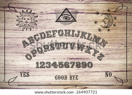 Ouija Board. Ouija style talking spirit board. - stock photo