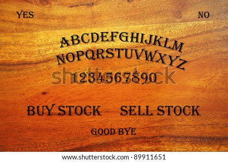 Ouija Board with a stock related question: buy or sell? - stock photo