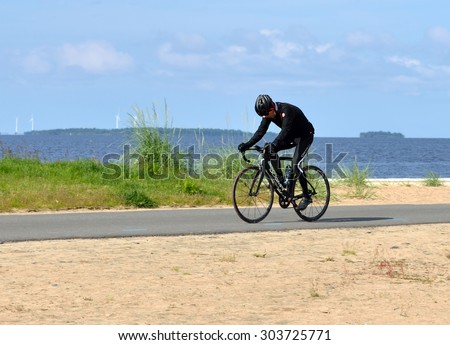 OULU, FINLAND - JULY 13, 2015:Nallikari Holiday Village and Camping locates by sea, approximately 4 kilometres from Oulu city centre. Here it is good to play sports and ride bike - stock photo