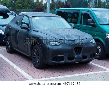 Oulx, Italy _ October  01, 2016  Prototype of a SUV car camouflaged parked in a public space while is testing on the road