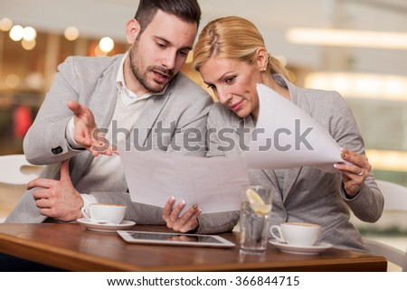oung businessman on a break at the restaurant, discuss new ideas and projects - stock photo