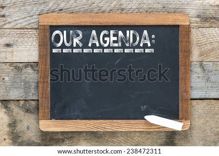 Our agenda sign. Our agenda sign on chalkboard - stock photo